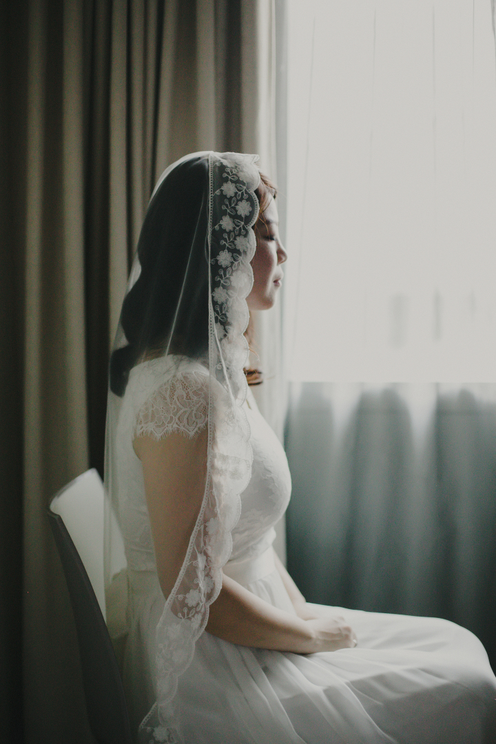 Bride with lay over veil